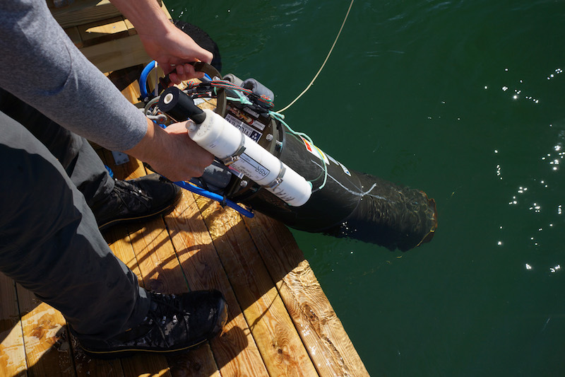 Fig. 1. The Imaging Flow Cytobot, a type of automated underwater microscope, is deployed at the Tångesund observatory. The white instrument is a CTD for measuring depth, temperature and salinity. Photo by Bengt Karlson.